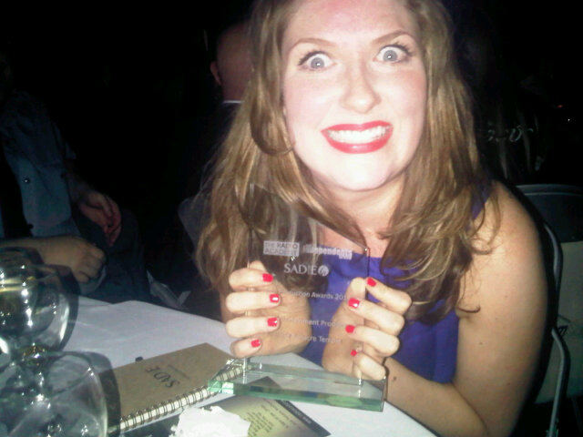Mariele Runacre Temple with a radio award looking excited